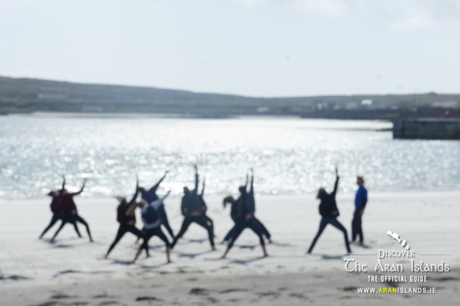 A touring group practicing Tai Chi on the Beach